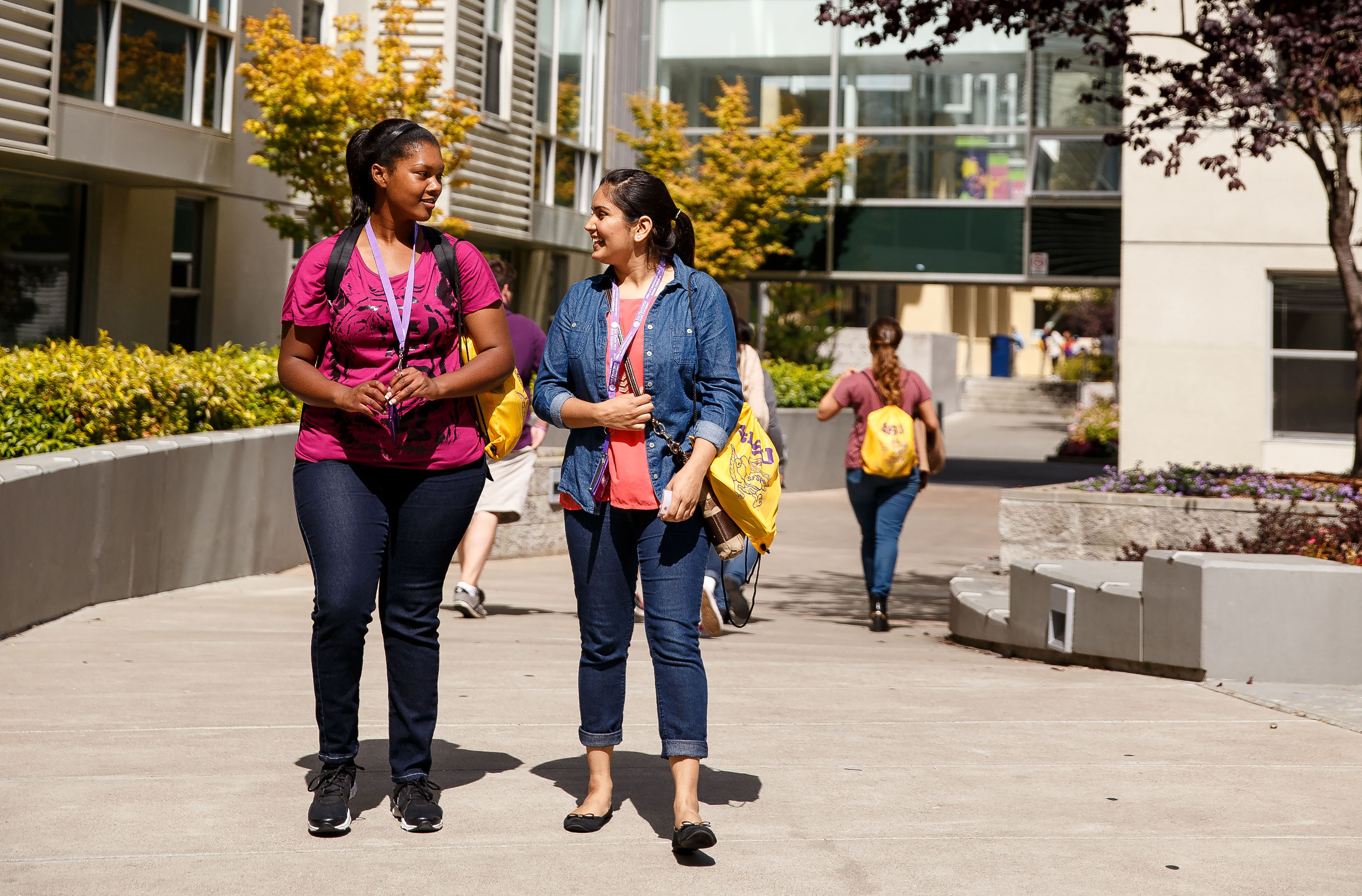 Students walking in front of student housing building