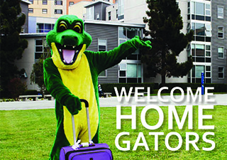 Gator in front of housing with suitcase