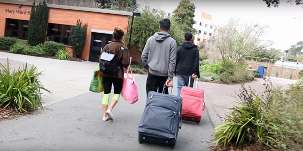 Future residents with suitcases