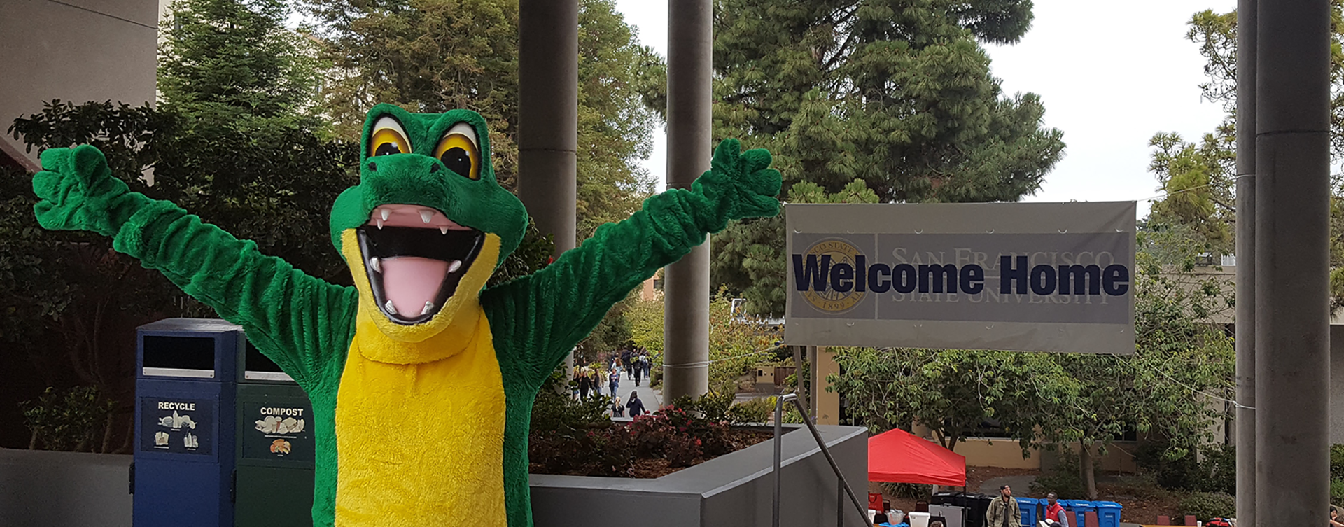 Gator mascot and welcome sign