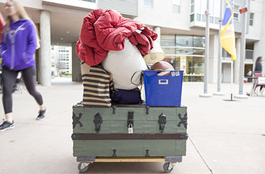 Luggage in front of student housing